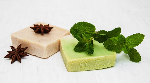 Homemade soap  with fresh mint leaves and anise