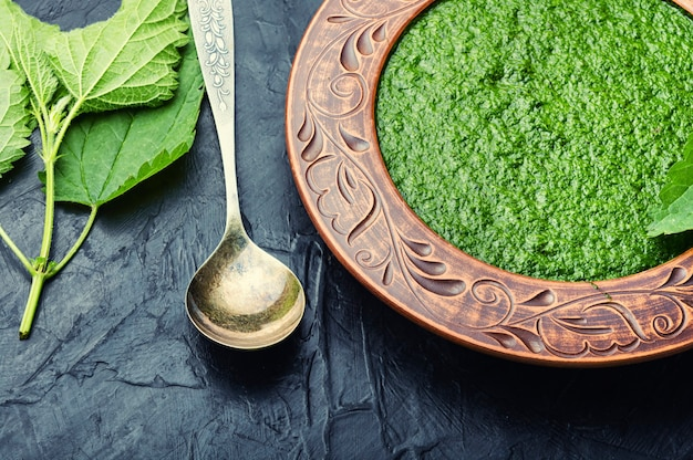 Homemade soup with fresh nettle leaves. creamy herbal soup. healthy food.