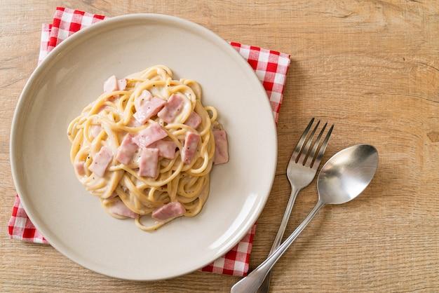 Homemade spaghetti white cream sauce with ham
