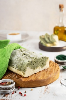Homemade spirulina alternative bread made from glutenfree rice and flax flour superfoods concept