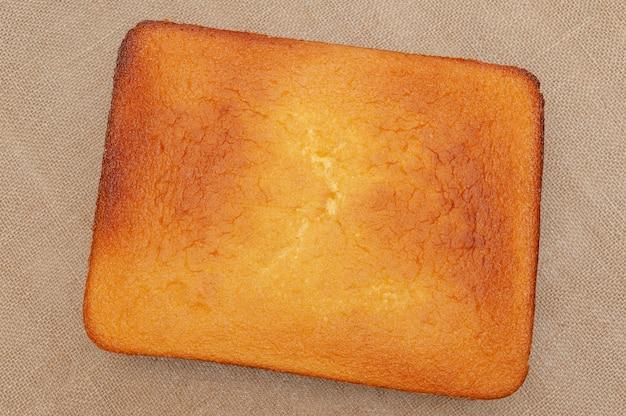 Homemade sponge cake in portuguese pao de lo top of the baked cake dough