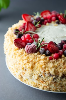 Homemade sponge cake with cream and fresh berries.  whole deliciouse cake.