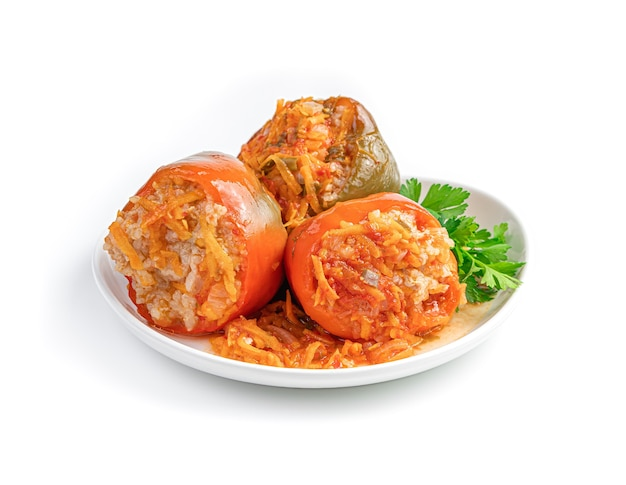 Homemade stewed stuffed pepper is isolated on a white background
