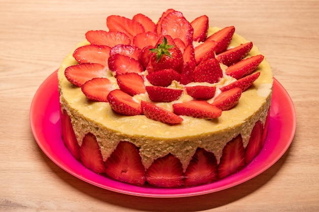 Homemade strawberry cake in a red dish