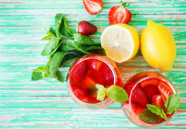 Homemade strawberry lemonade on a rustic background, a refreshing summer drink, top view