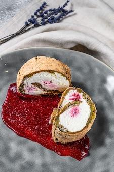 Homemade strawberry shortcake cake roll with cream cheese