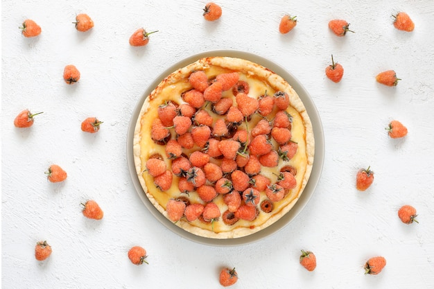 Homemade summer berry tar pie, different berries, golden raspberry, blackberry, red currant, raspberry, black currant, top view