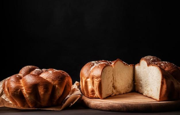 Homemade sweet bread on black background