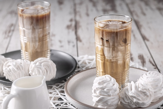 Homemade sweet breakfast for two persons, iced coffee drink with homemade zephyr still life, horizontal