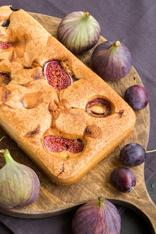 Homemade sweet cake with figs and plums
