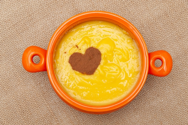 Homemade sweet corn pudding known in brazil as curau or canjica nordestina in ceramic bowl.