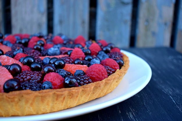 Homemade tart or pie with summer berries.