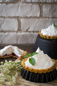Homemade tart with berries and icing, cream, whipped cream