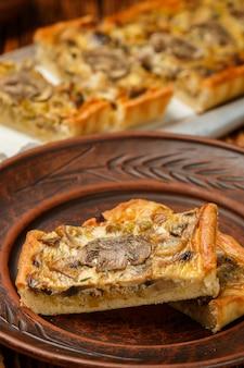 Homemade tart with mushrooms, leek, cheese and thyme