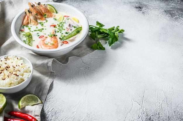 Homemade tom kha gai. coconut milk soup in a bowl. thai food. .