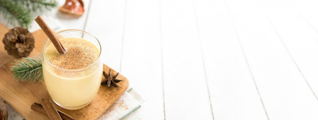Homemade traditional christmas eggnog drink in a glass