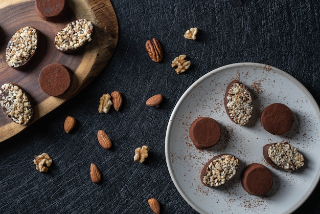 Homemade truffles from dark chocolate on a plate