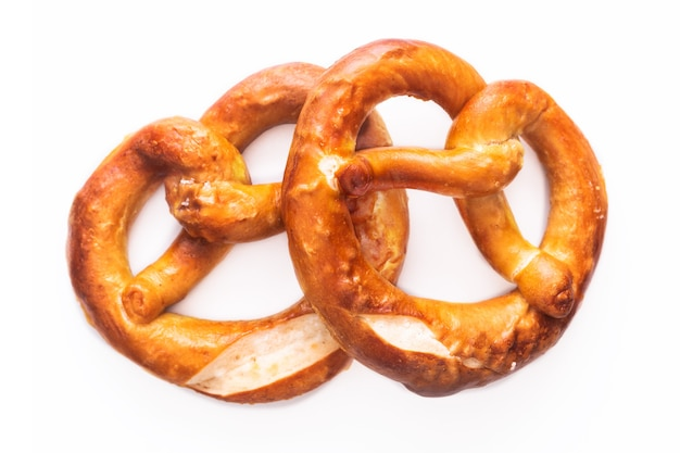 Homemade twisted knot soft salt pretzels on white background