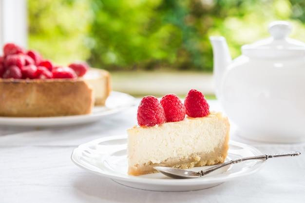 Homemade vanilla cheesecake with raspberries