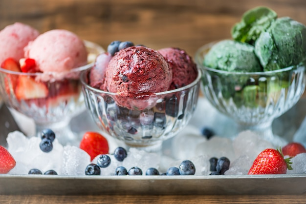 Homemade vegan nice cream or sorbet from banana, spinach, strawb