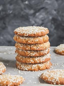 Homemade vegan tahini cookies in stack, close up