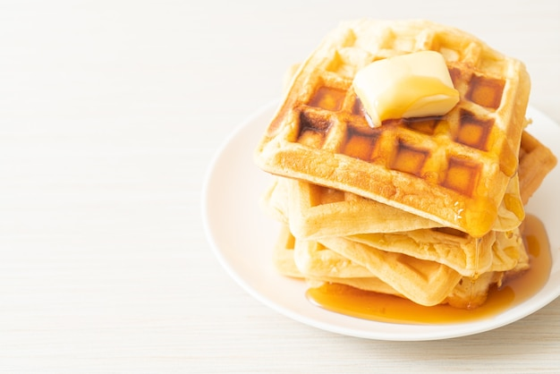 Homemade waffle stack with butter and honey or maple syrup