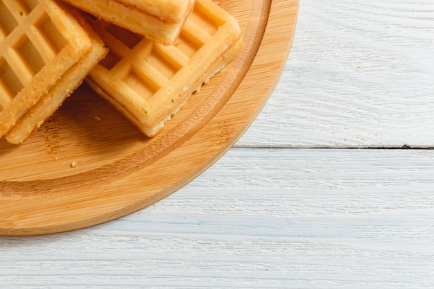 Homemade waffles with jam on old wooden table