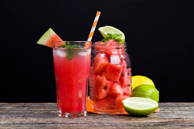 Homemade watermelon juice made in the summer or autumn season from ripe red and juicy watermelons, red juice without added sugar, a natural healthy and dietary product