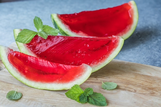 Homemade watermelon and mint dessert. jelly in a watermelon  on a light background.