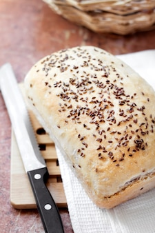 Homemade wheat bread with flax seeds on a kitchen table