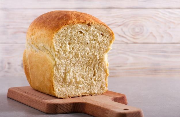 Homemade white bread, sliced on board
