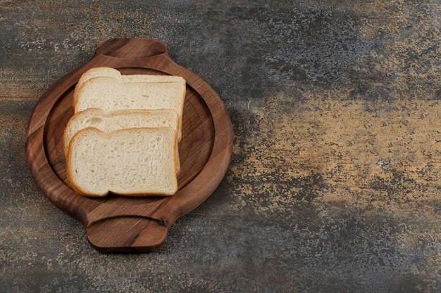 Homemade white bread on wooden board