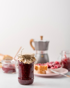 Homemade wild berry jam and blurred background