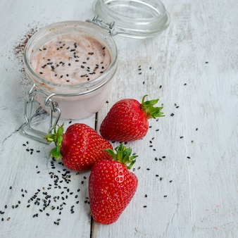 Homemade yogurt in a jar with strawberry