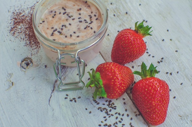 Homemade yogurt in a jar with strawberry