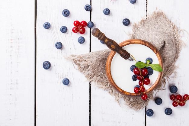 Homemade yogurt, sour cream of  blueberries red currants