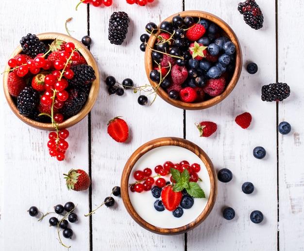 Homemade yogurt, sour cream different berries