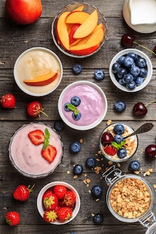 Homemade yogurt on a wooden background top view