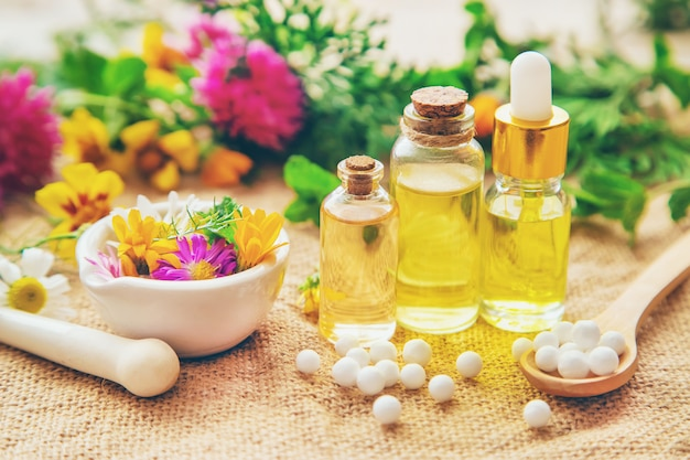 Homeopathy, herbal extracts in small bottles.