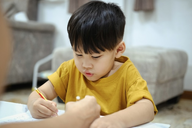 Homework teaching education mother children son familiy childhood.