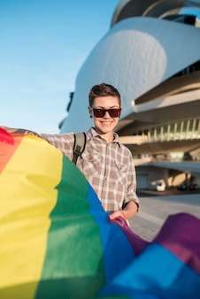 Homosexual with flying rainbow flag