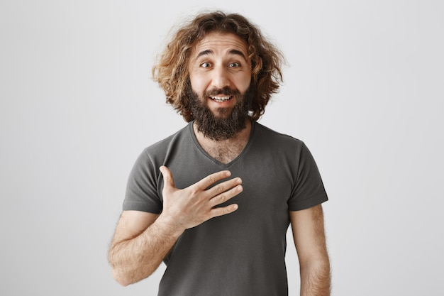 Honest middle-eastern man pointing at himself as being sincere