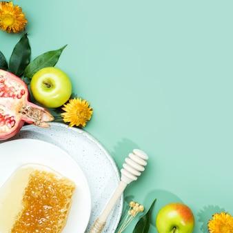 민트 그린 배경 개념에 꿀 사과와 석류 유태인 새해 해피 홀리데이 rosh