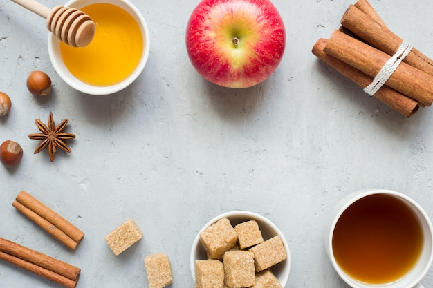 Honey and apple, brown sugar and anise with cinnamon on a light background