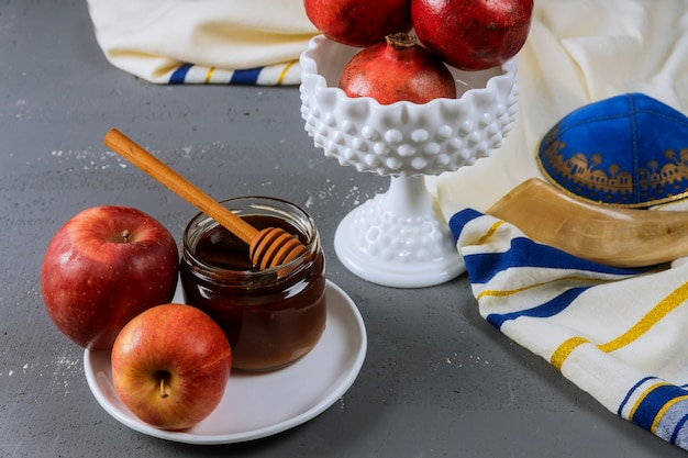 Honey and apples on jewish holiday rosh hashanah torah book