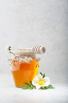 Honey background. sweet honey in the glass jar.