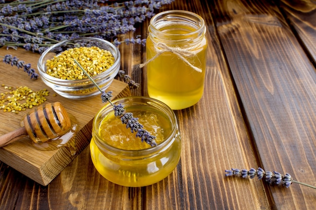Honey and bee pollen on the wooden table