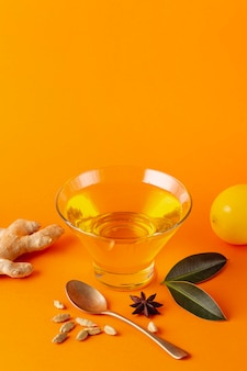 Honey bowl with ginger and lemon with copy space
