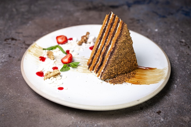 Honey cake on a white plate photo for the menu