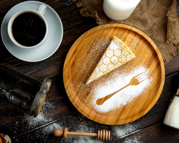 Honey cake with espresso on the table